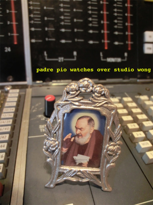 padre pio watches over studio wong